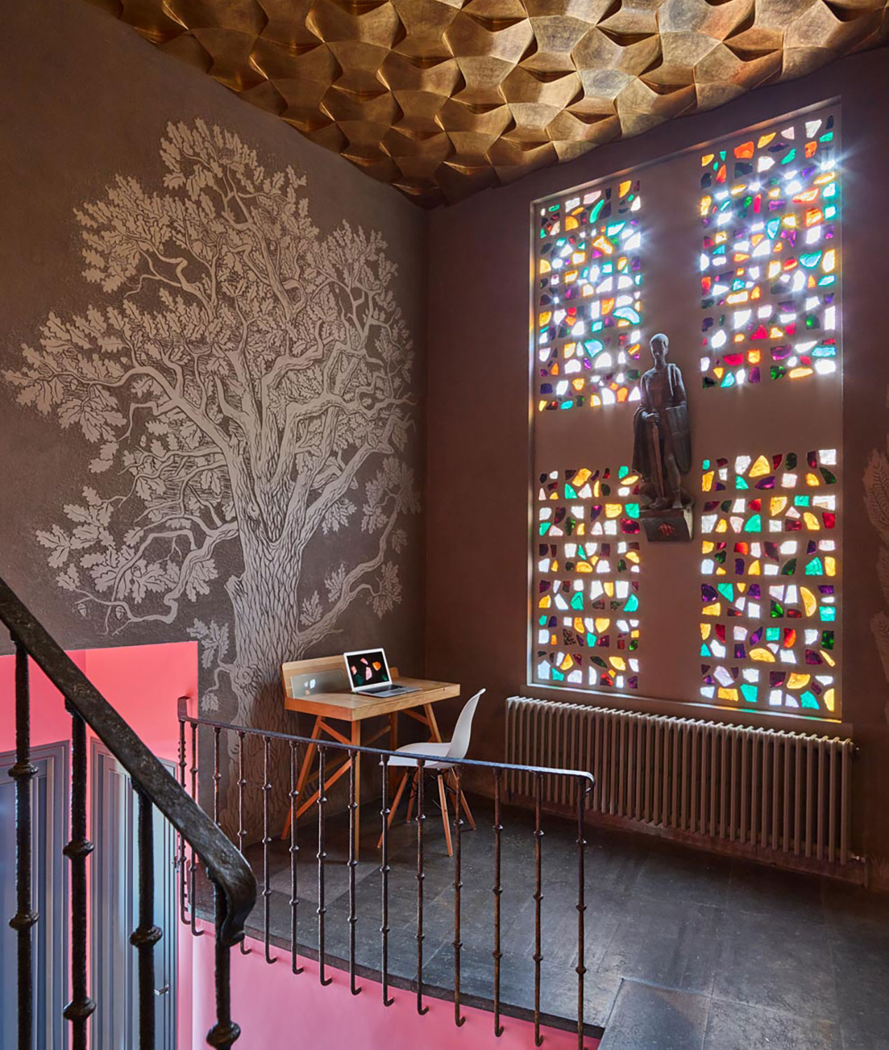Casa creueta colourful entrance hall with stained glass windows and etched wall art