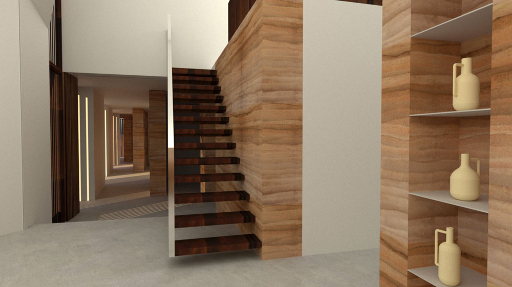 wooden stair cantilevered off rammed earth wall in the new build in Matarraña
