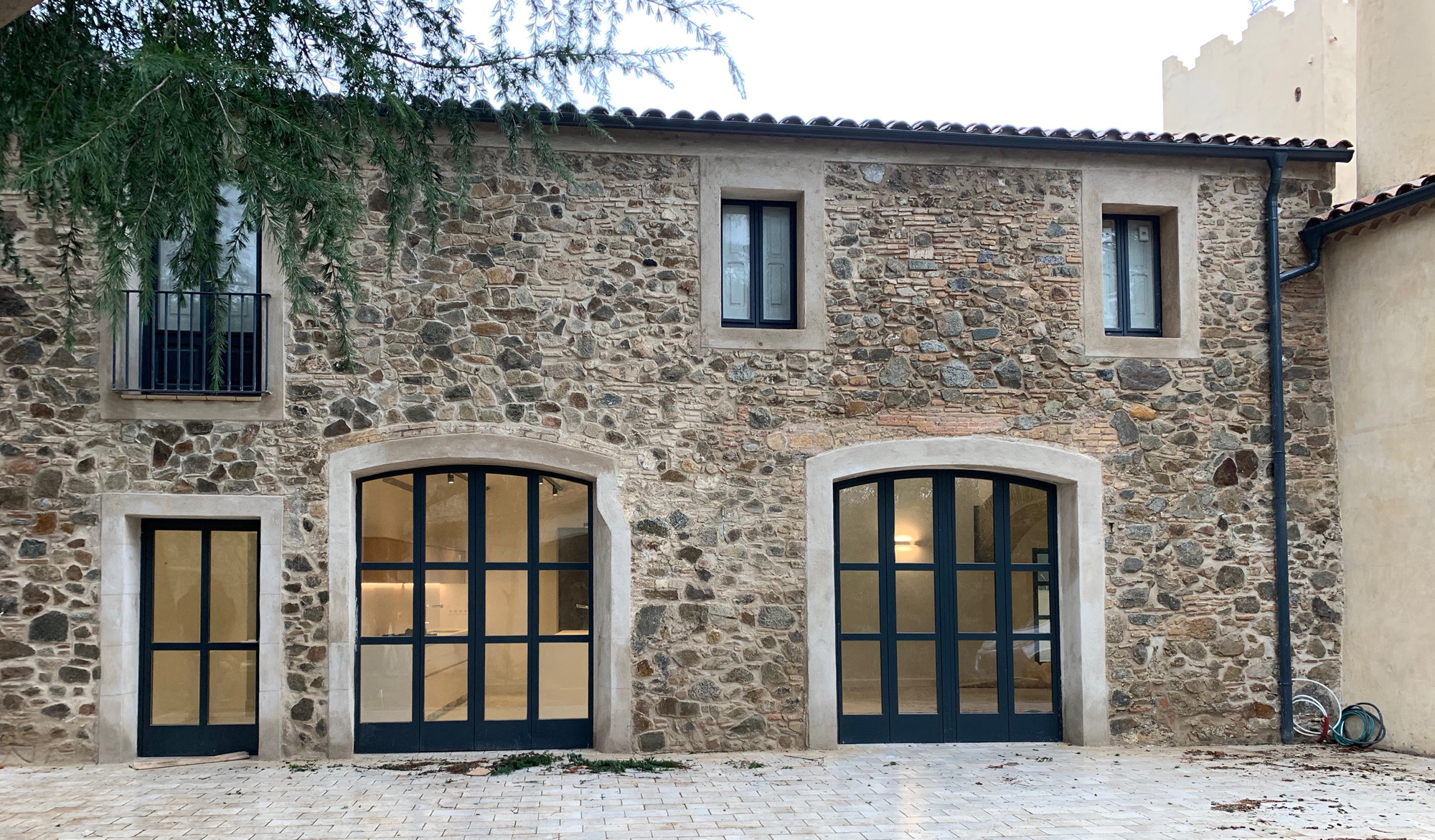 steel windows in stone facade